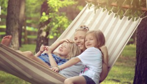 Family sitting in hammock